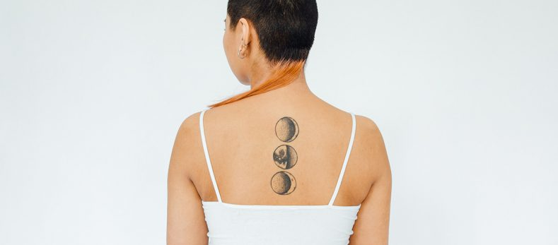 how painful is a spine tattoo?